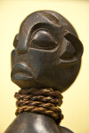 Cameroon Wood Carving of Man with Large Head, Flattened Nose, Large Ears and Spherical Eyes (Close Up)