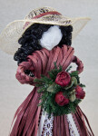Canada  Handcrafted Doll with Straw Hat, Artificial Bouquet of Roses, and Dress Made from Ribbons (Close Up)