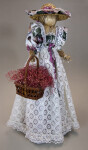 Canada Ontario Straw Figure with Pinafore Style Dress Made from Flowery Print, Lace, and Ribbon (Three Quarter View)