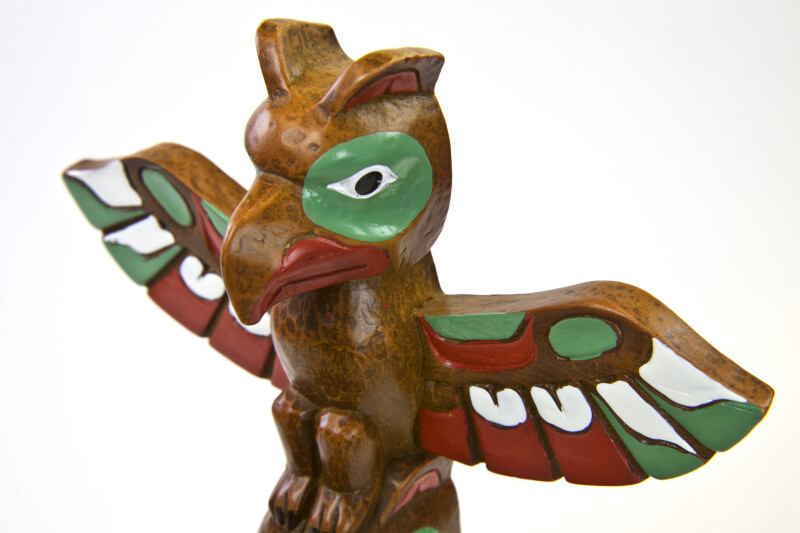 Canada Totem Pole with Painted Winged Eagle at Top (Close Up)