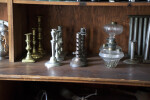 Candlesticks and Lamps on a Shelf