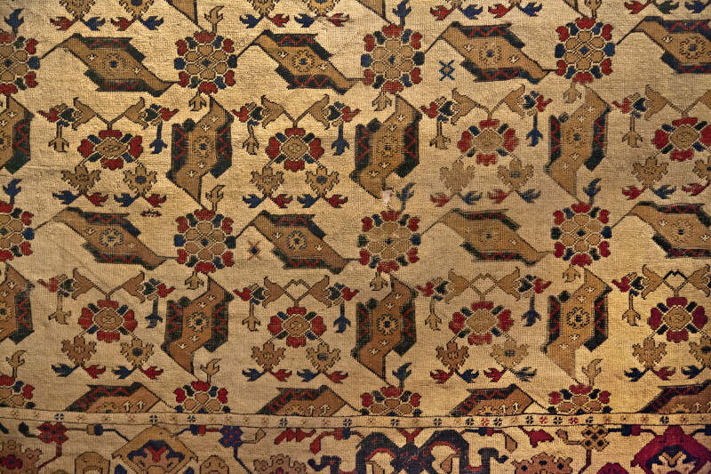 Carpet Resembling Birds and Leaves