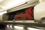Carry-On Luggage Stowed in an Overhead Compartment