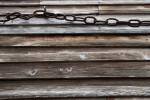 Chain Links Running through a Metal Eyelet