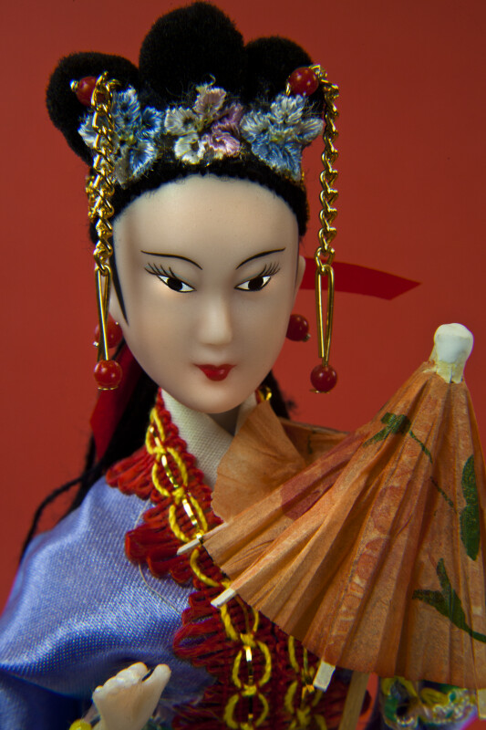 China Doll from Hong Kong with Ornamental Hair Piece and Parasol (Close Up)