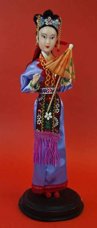 China Hong Kong Doll Made with Rubber Wearing a Brocade Apron (Full View)