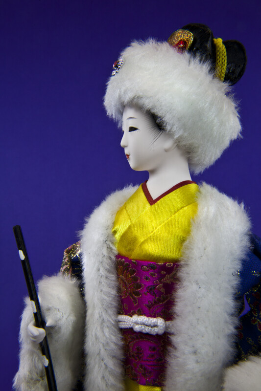 China Porcelain Geisha Lady Wearing Kimono and Hat Trimmed in Fur (Close Up)