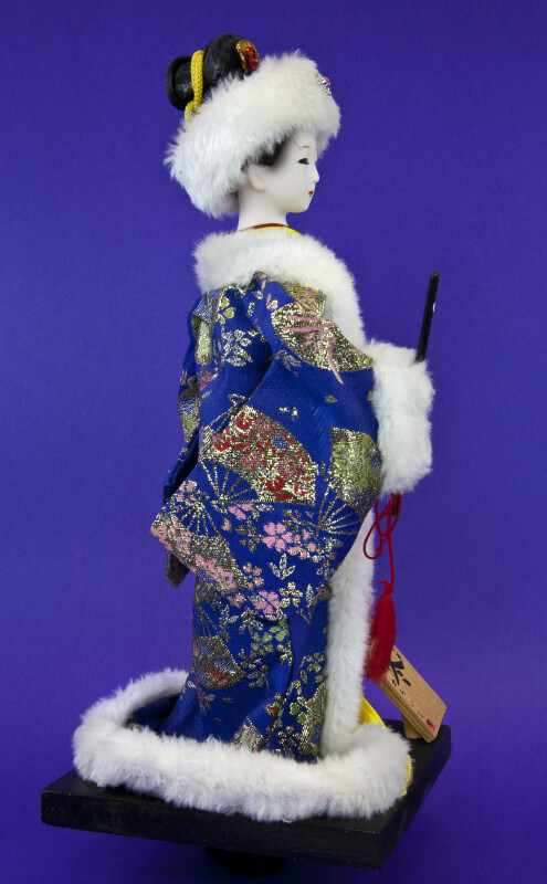 China Winter Doll with White Fur Hat and Trim on Brocade Coat (Profile View)