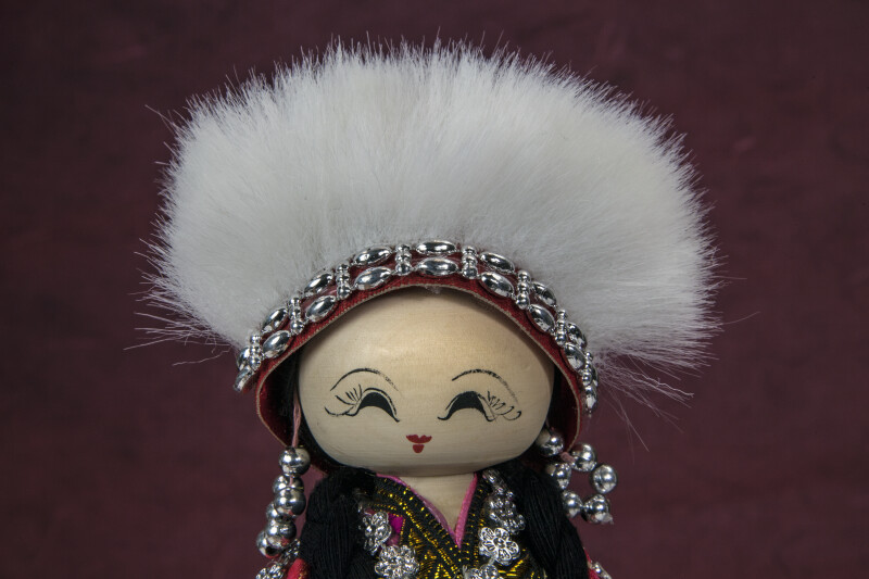 China Woman with Wood Face that is Hand Painted (Close Up)
