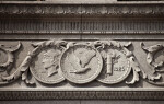 Coins Carved on a Bank Building