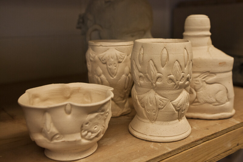 Collection of Embellished Ceramic Cups and Jars