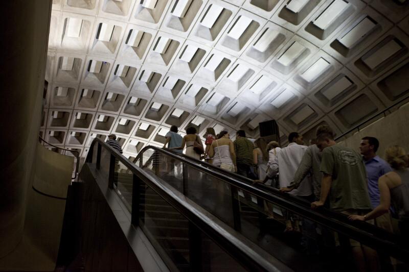 Commuters on Escalator
