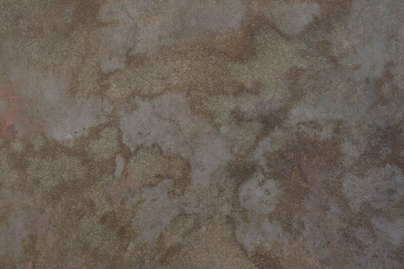 Concrete Floor with Tan and Grey Patches