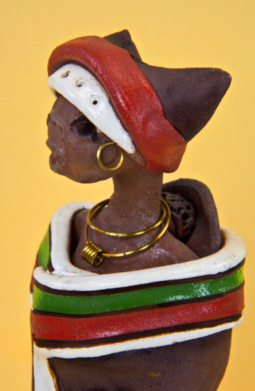 Congo African Handcrafted Clay Figure of a Woman Wearing a Gold Wire Necklace and Earrings (Close Up)