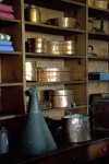 Copper Pots and Other Goods on Shelves