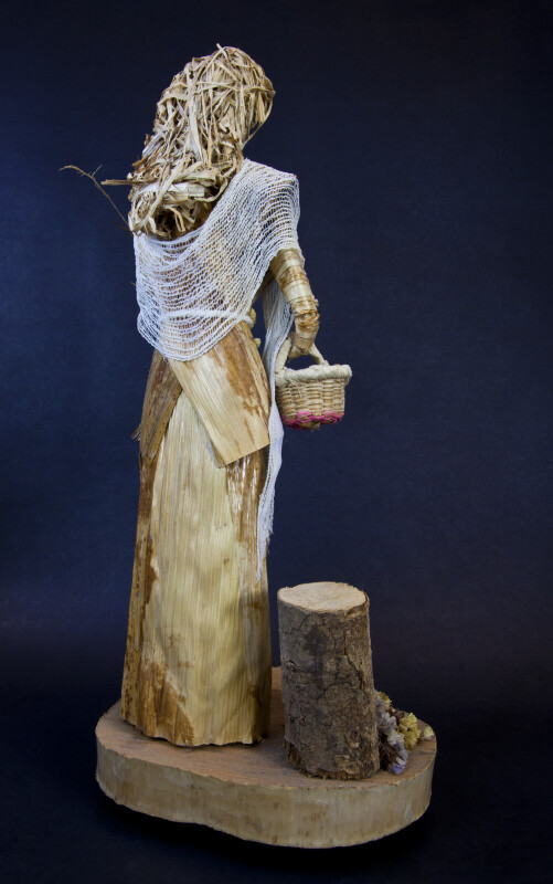 Costa Rica Figure with Corn Husk Dress Holding Straw Basket (Back View)