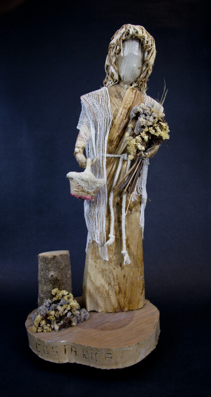 Costa Rica Handcrafted Figure Made with Wood, Corn Husks, and Fish Net (Full View)