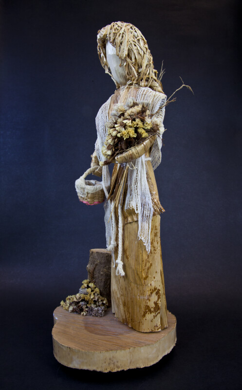 Costa Rican Doll Statue with Wood Base and Corn Husk Dress (Three Quarter View)