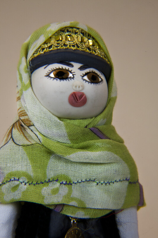 Croatia Hand Painted Face of Female Doll with Gold Headband and Cotton Head Scarf (Close Up)
