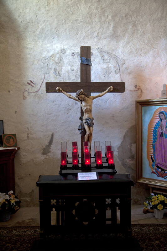 Crucifix with Candles at Mission Concepción Belfry