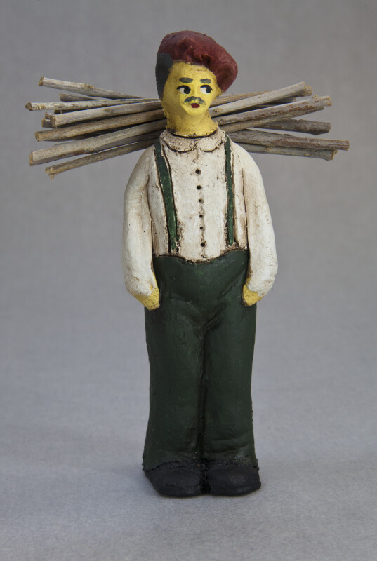 Cyprus Man Made with Ceramics Who Is Carrying a Load of Sticks on His Back (Full View)
