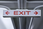 Dim Exit Sign with Arrows