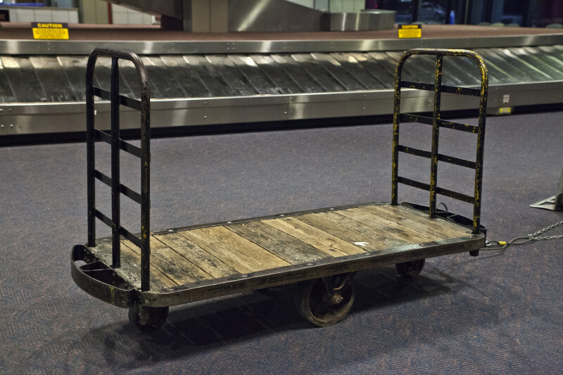 Dolly Near a Luggage Pick-Up Station at Pittsburgh International Airport
