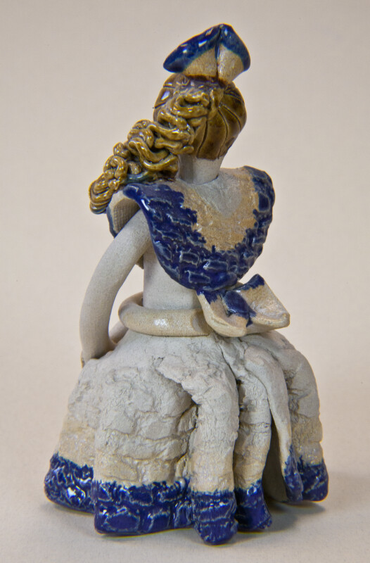 Dominican Republic Ceramic Doll with a Bow in Her Hair and a Large Bow at the Back of Her Dress (Back View)
