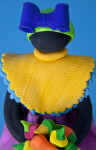 Dominican Republic Colorful Doll Holding Basket of Fruit Made with Porcelana Fria (Close Up)