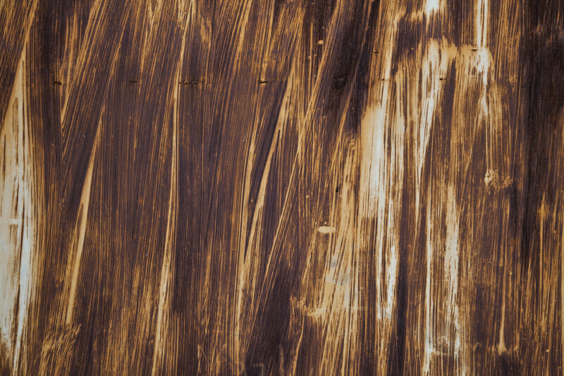 Door Painted in Brown Streaks Close-Up