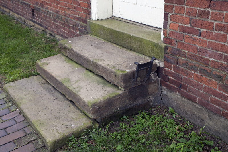 Dressed Stone Steps with a Boot Scraper on the Top Step