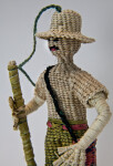 Ecuador Handcrafted Male Figure Made with Woven Straw Holding a Pole (Close Up)