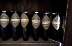 Empty Wine Bottles on a Drying Rack