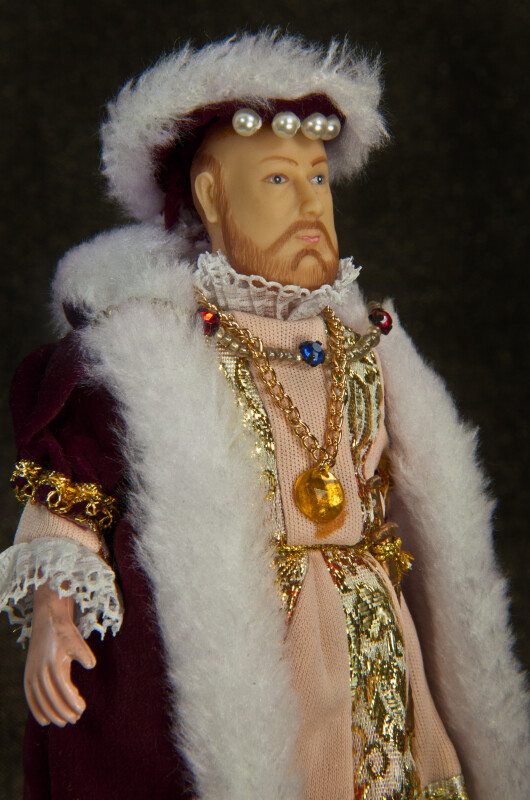 England King Henry VIII Figure Ornately Dressed in Velvet, Lace, Pearls, and Gold (Three Quarter View - Dark Background)