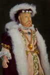England King Henry VIII Figurine Ornately Dressed in Velvet, Lace, Pearls, and Gold (Three Quarter View - Dark Background)