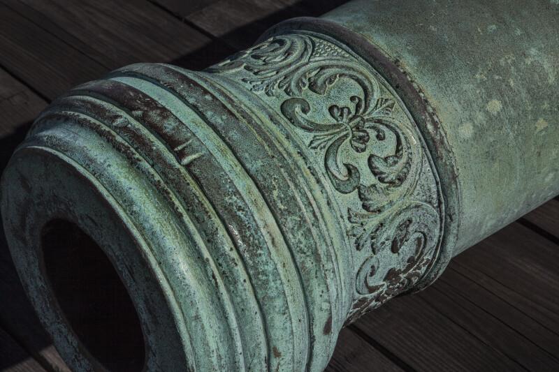 Fleur-de-Lis Designs on a Cannon Near its Barrel