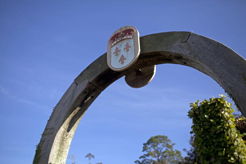 Fleur-de-Lis Plaque on a Wooden Archway