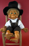 Florida Naber Kids Doll Gilbert Sitting on Chair Wearing Large Black Felt Hat (Full View)