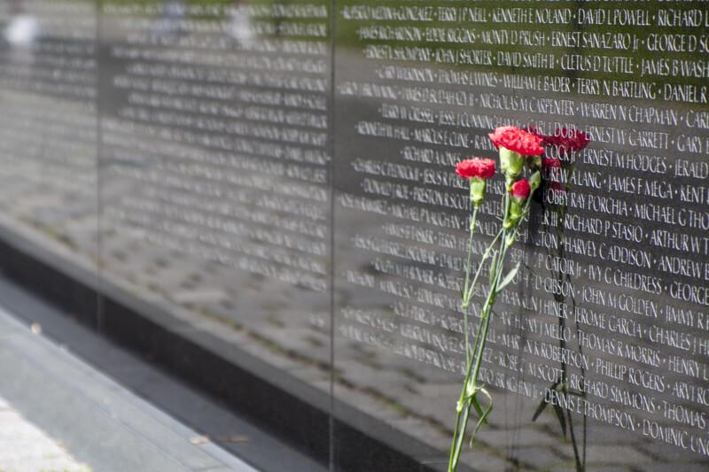 Flowers at Memorial Wall