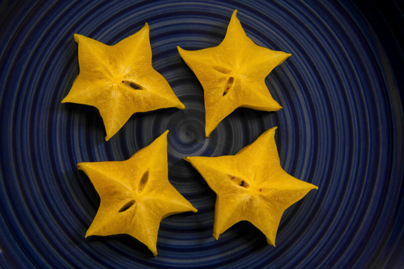 Four Starfruit Cut into Star Patterns