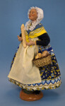 France French Doll with Lace Cap Holding Baguette and Straw Basket with Bread (Three Quarter View)