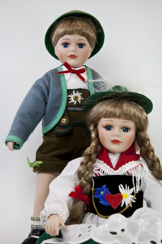 Germany Bavarian Boy and Girl Dolls by Schneider in Traditional Clothing with Hats and Lederhosen (Three Quarter View)