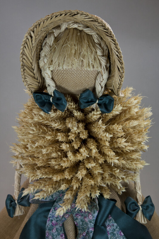 Germany Doll with Wheat Torso and Straw Arms Wearing Straw Hat over Straw Braids (Close Up)