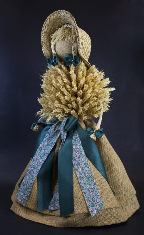 Germany Female Doll with Burlap Skirt, Wheat Sheaf Bodice, and Straw Hat (Three Quarter View)