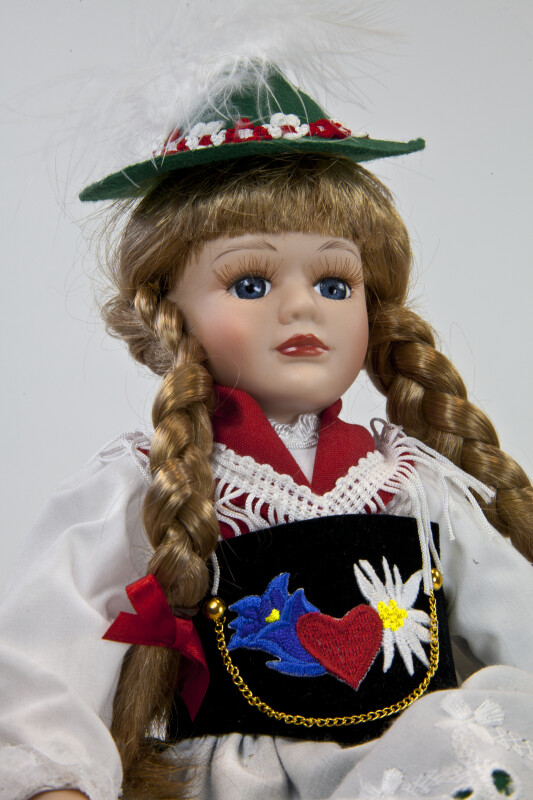 Germany Girl Wearing Traditional Dirndl, Apron, Shawl, and Hat (Close Up)