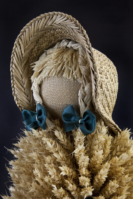 Germany Hand Made Woman with Burlap Face and Straw Braids under Straw Hat (Close Up)