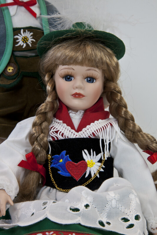 Germany Handcrafted Bavarian Doll with Shawl, Hat, and Traditional Dress by Schneider Company (Three Quarter View)