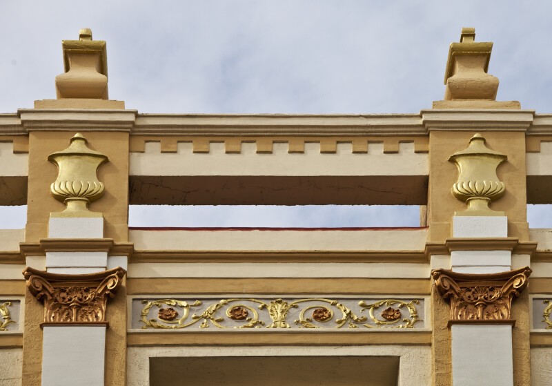 Gold Urns Adorning a Building