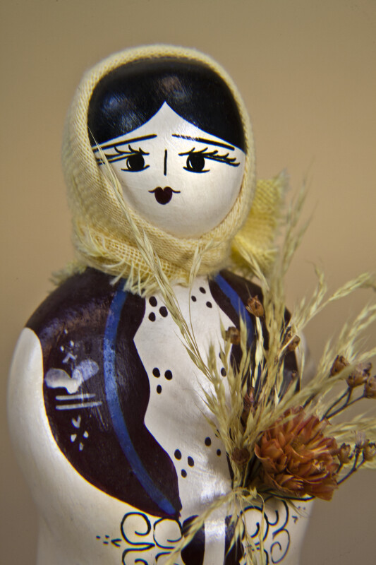 Greece Handcrafted Ceramic Doll with Straw Flowers and Cotton Scarf (Close Up)