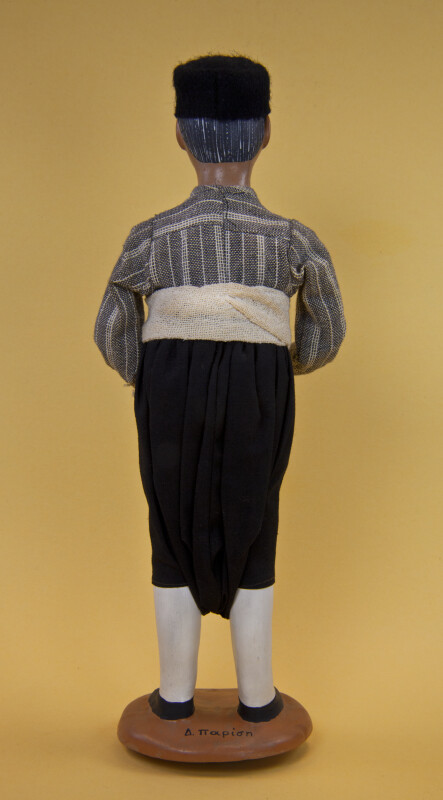 Greece Man Made with Ceramic and Wire Wearing Felt Hat, Vraka Pants, and Sash (Back View)